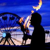 Paul Isaak Juggling Fire, in front of Ferris Wheel at Tanana Valley State Fair