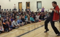 Paul Isaak wows students by combining skillful juggling with comedy