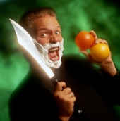 Paul Isaak About to shave his face with a huge knife while juggling it.